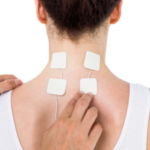 A photo of TENS machine electrodes placement for migraines